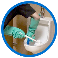 Aire-Master service rep cleaning urinal