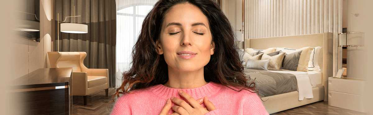 Woman enjoying scent in hotel room or apartment